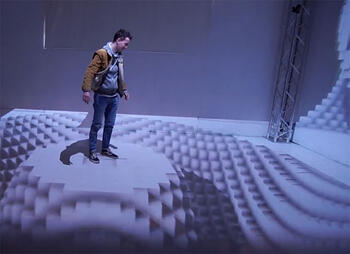 Man standing in 3D projection mapping space