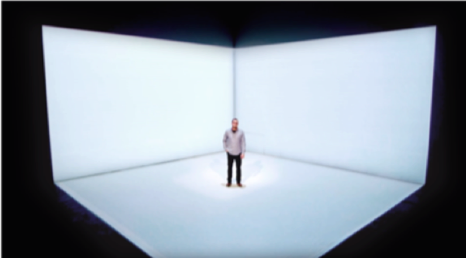 Man standing on an empty stage