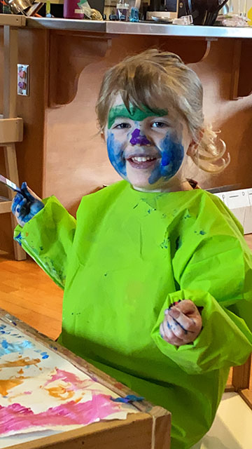 VMG Studios producer's daughter with paint on her face while virtual learning during COVID-19