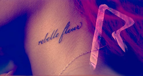 "Rihanna's French tattoo which reads ""rebelle fleur"""