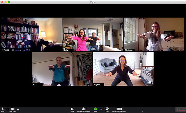 Group of people on a Zoom video call doing squats