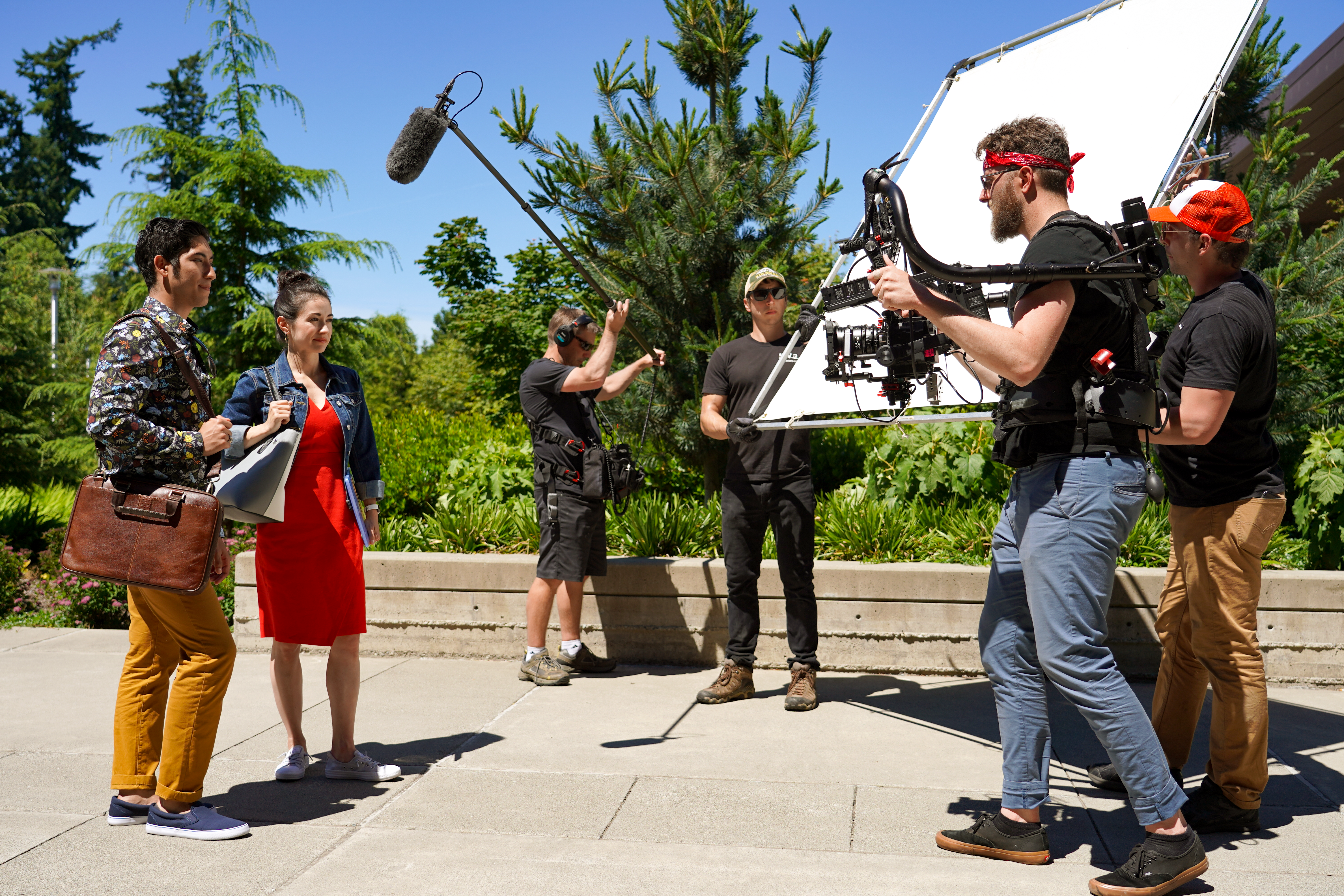 Video production shoot of a young male and female adult looking at a cameraman