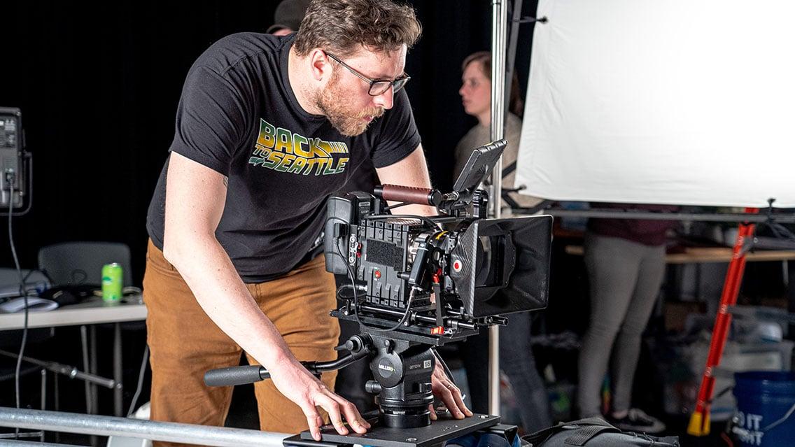director of photography cinematographer adjusting camera