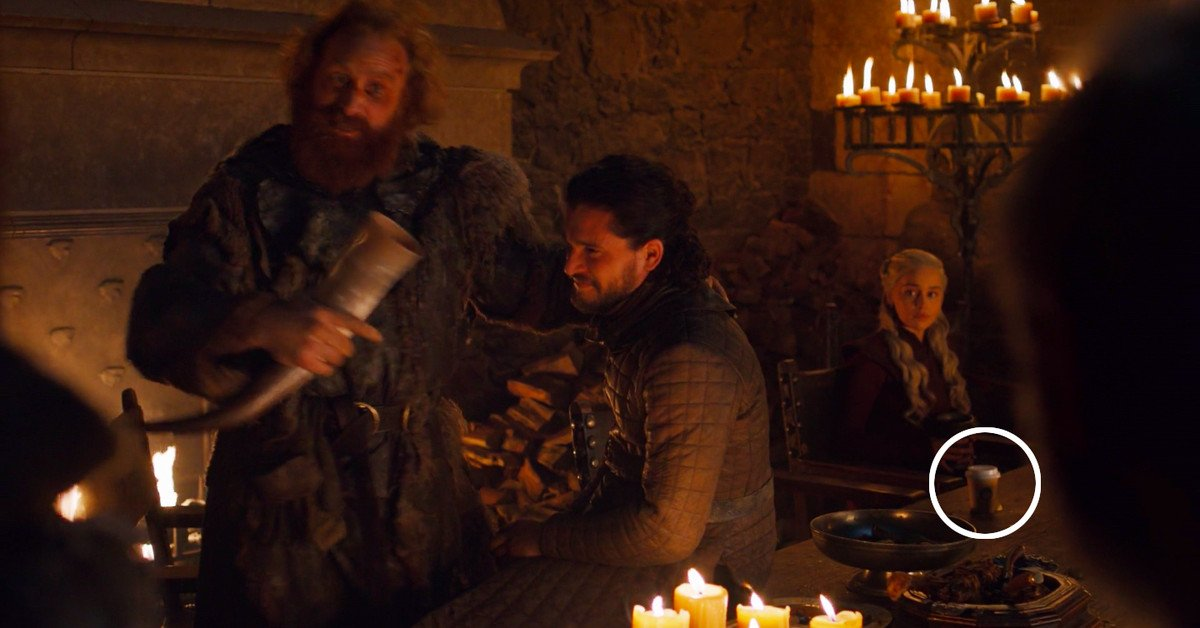 Scenes from Game of Thrones of a Starbucks coffee cup on a table in a scene with Jon Snow and Daenerys Targaryen
