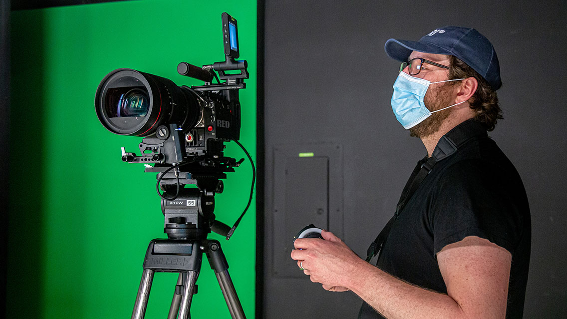 Director of Photography looking at camera in-studio while wearing a mask during COVID-19