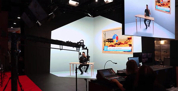 Man sitting in a studio in a makeshift office space with extended reality technology