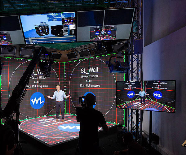 Behind the scenes of a man standing in a mixed reality studio space