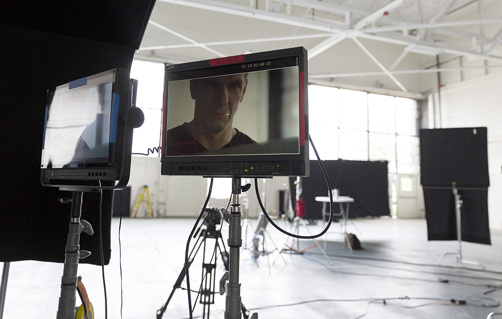 Video preview monitor on a live-action video shoot in a warehouse setting