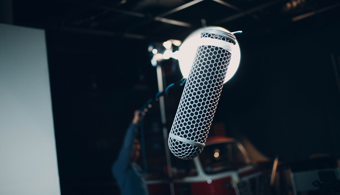 Microphone sitting in a studio space recording room tone at VMG Studios