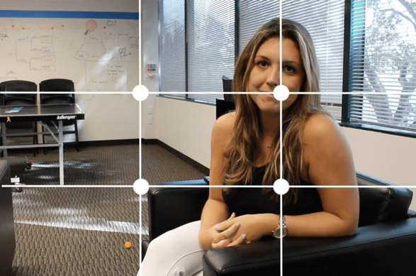 Woman smiling at webcam off-center presentation rule of thirds framing style
